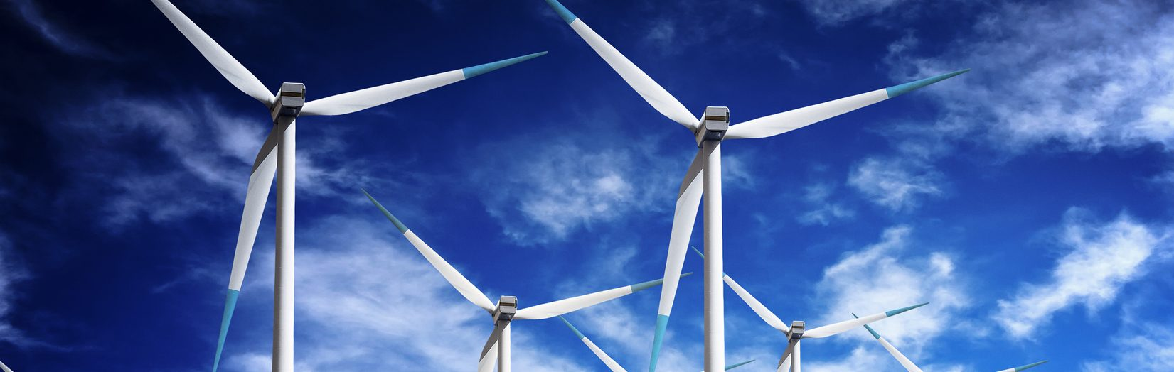 Photo of wind turbines blue sky